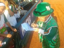 Scotty signing autographs for his fans.